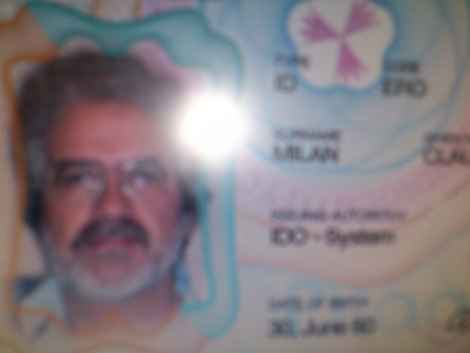 An unacceptable blurry/out of focus ID, with details masked:
